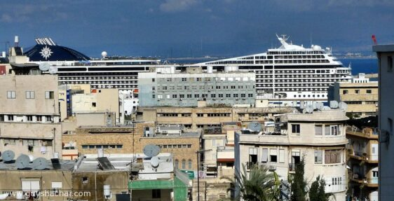 MSC Magnifica Cruise Ship dominates the skyline of Haifa