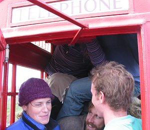 How many backpackers can squeeze into a red telephone booth?